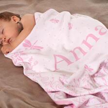 Babydecke mit Wiese und Namen.